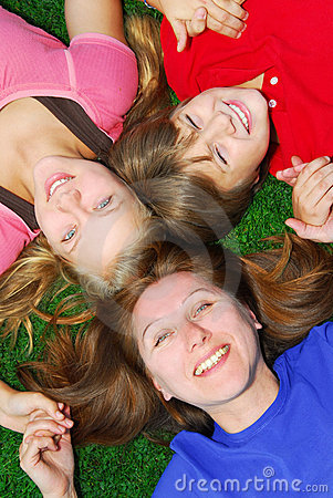 Family lying down on grass
