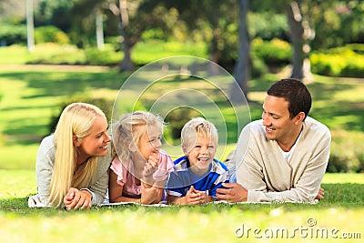 Family lying down outside