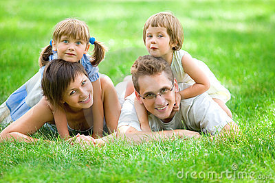 Family lying on grass