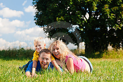 Family lying on meadow