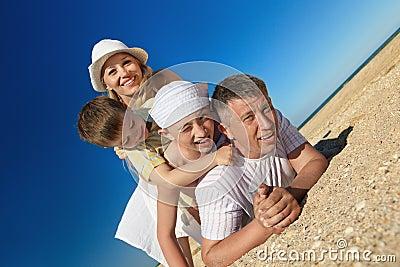 Family lying on sand