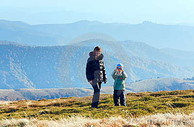 Family make photo on autumn  mountain plateau