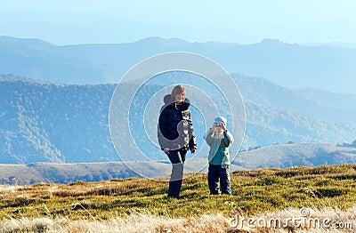 Family make photo on autumn  mountain plateau