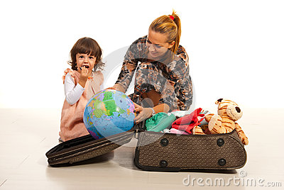 Family make their luggage for travel