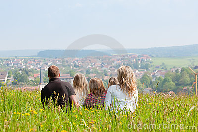 Family on meadow in spring or early summer