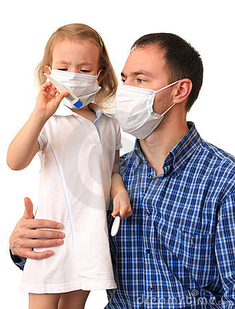 Family in medical masks with a thermometer.