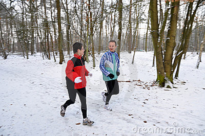 Family members running in the snow