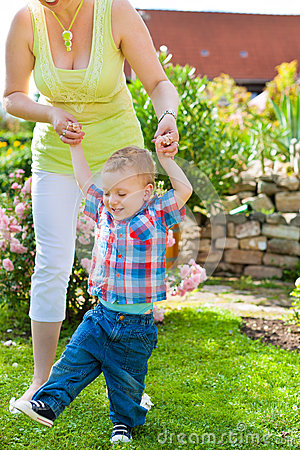 Family - mother and child in garden