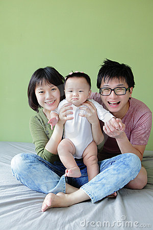 Family (Mother, father and small baby) smile face