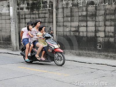 Family on a Motorbike Editorial Photo