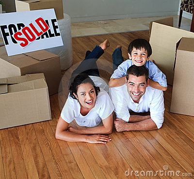 Free Family Moving House On Floor Smiling At The Camera Stock Photo - 9888170