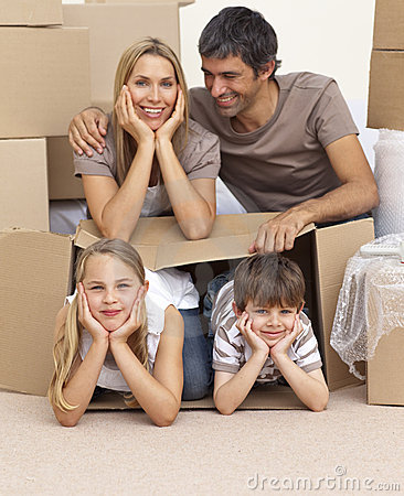 Free Family Moving House Playing With Boxes Stock Photos - 11662803