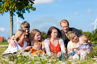 Family and multi-generation - fun on meadow in sum
