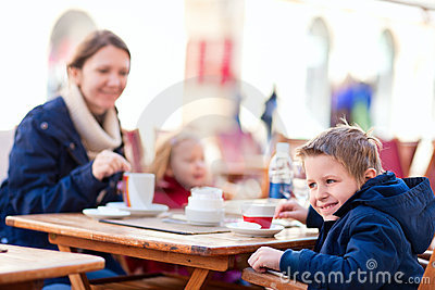 Family at outdoor cafe