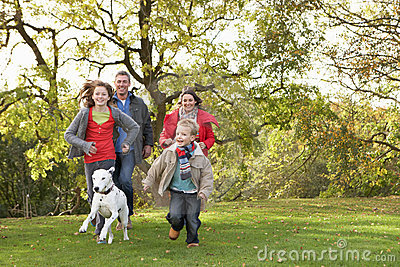 Family Outdoors Walking Through Park