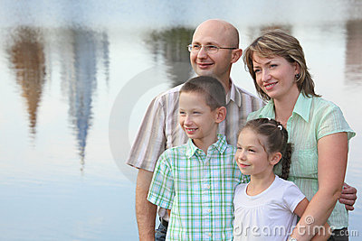 Family In Park On Pond Background Royalty Free Stock Images - Image: 13020789