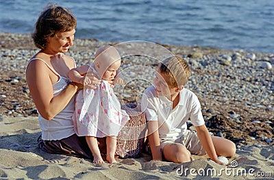 Family play on a beach