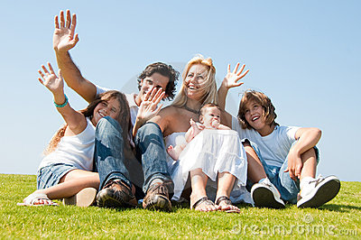 Family play on meadow