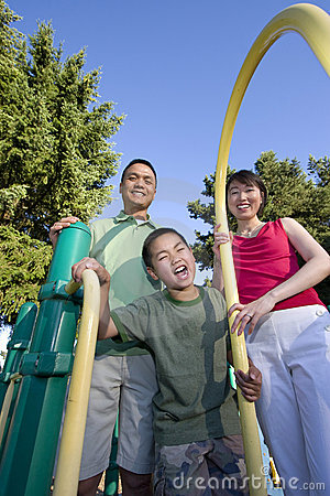 Family on Playground Smiling - Vertical