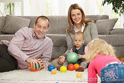 Family playing with balls