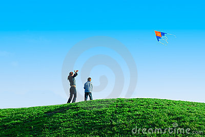 Family playing a kite