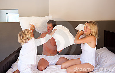 Family playing with pillows
