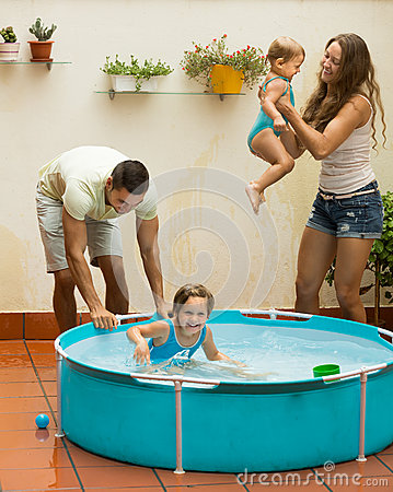 Family playing in pool at terrace stock photo image for Kids on the terrace