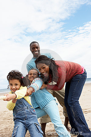 Free Family Playing Tug Of War On Beach Royalty Free Stock Photo - 19683835
