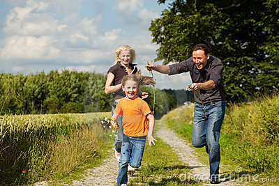 Family playing at a walk