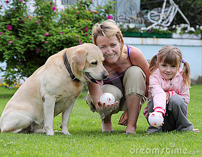 Family Plays With A Dog Royalty Free Stock Photos - Image: 10962388
