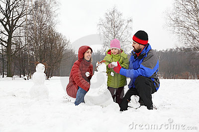 Family plays in park in winter