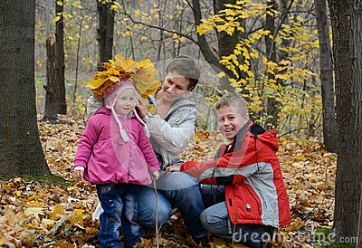 Family plays in the woods