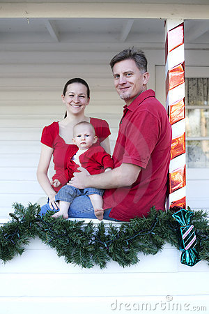 Family on porch at Christmas