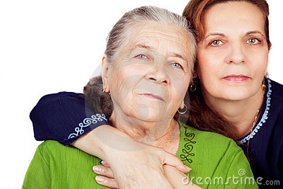 Family portrait - happy daughter and old mother