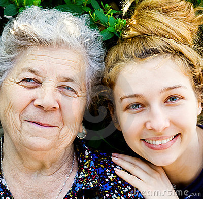 Family portrait - happy senior woman and daughter