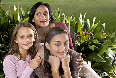 Family portrait, mother with beautiful daughters