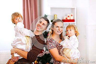 Family portrait near Christmas tree