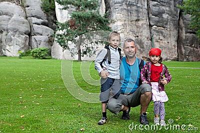 Family portrait beside rocks