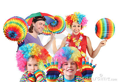 Family with rainbow hat umbrella on head