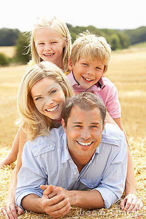 Free Family Relaxing In Summer Harvested Field Royalty Free Stock Image - 15555036