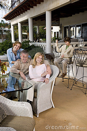 Family relaxing on outdoor patio