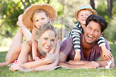 Family Relaxing In Park Together