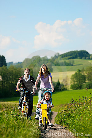 Free Family Riding Bicycles In Summer Stock Photos - 16420133