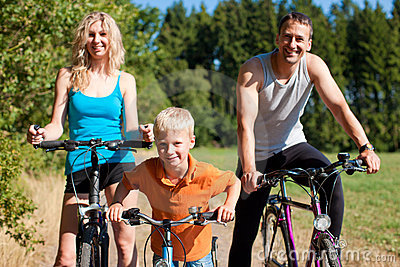 Family riding bicycles for sport