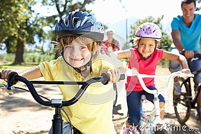 Family riding bikes having fun