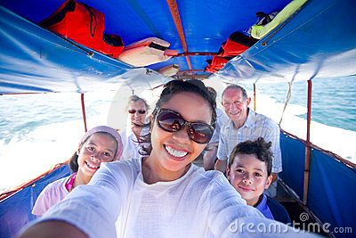 Family riding a fat boat going to an island.