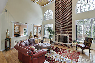 Family room with two story brick fireplace