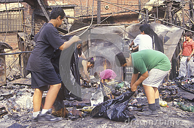 Family rummaging through home burned during riots Editorial Stock Photo