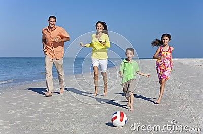 Family Running on Beach With Football Ball