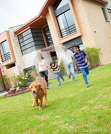 Family running with a dog